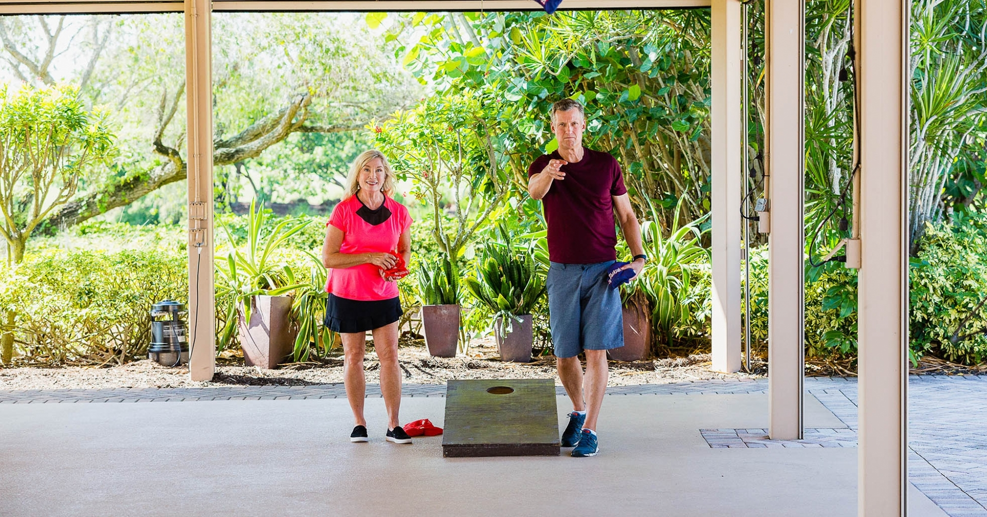 Couple plays cornhole at the best hotel on Sanibel Island