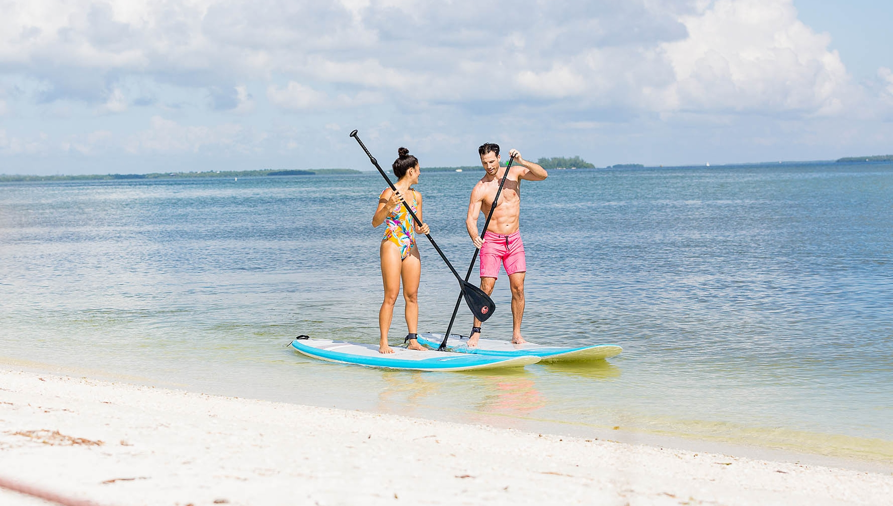 Couple on Paddle Boards on Sanibel Island