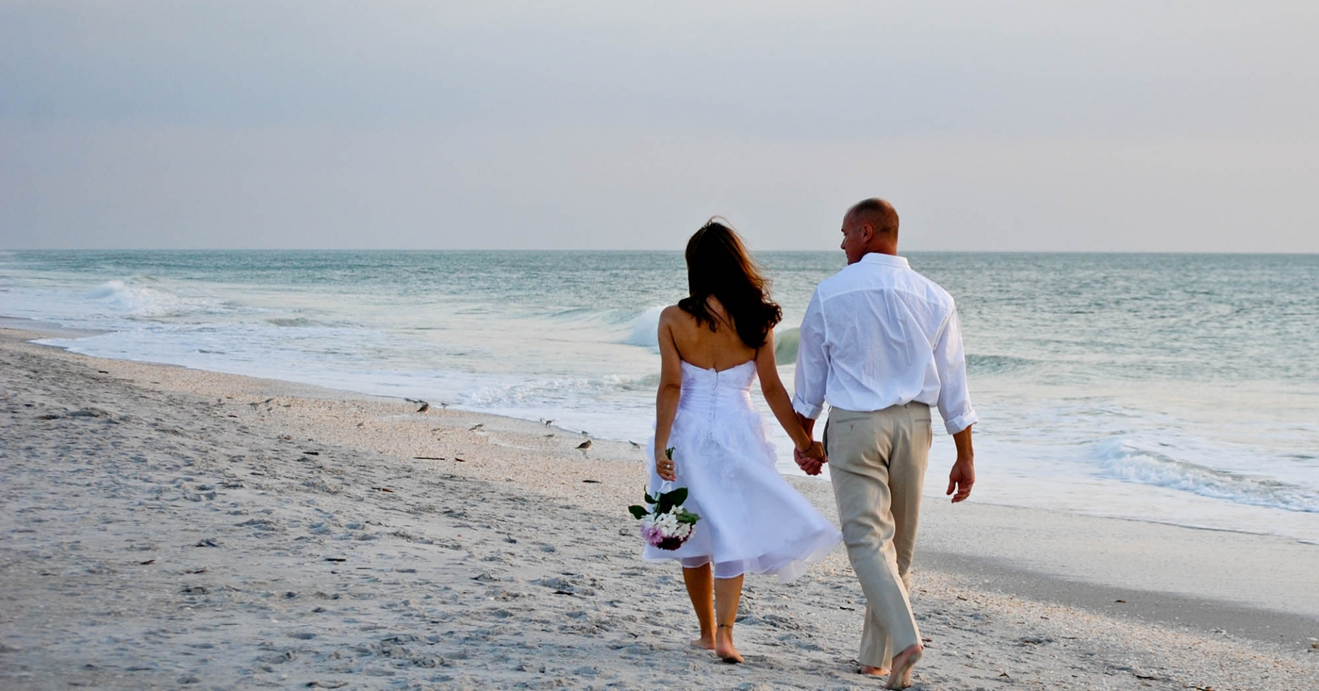Couple walking on a Sanibel Beach