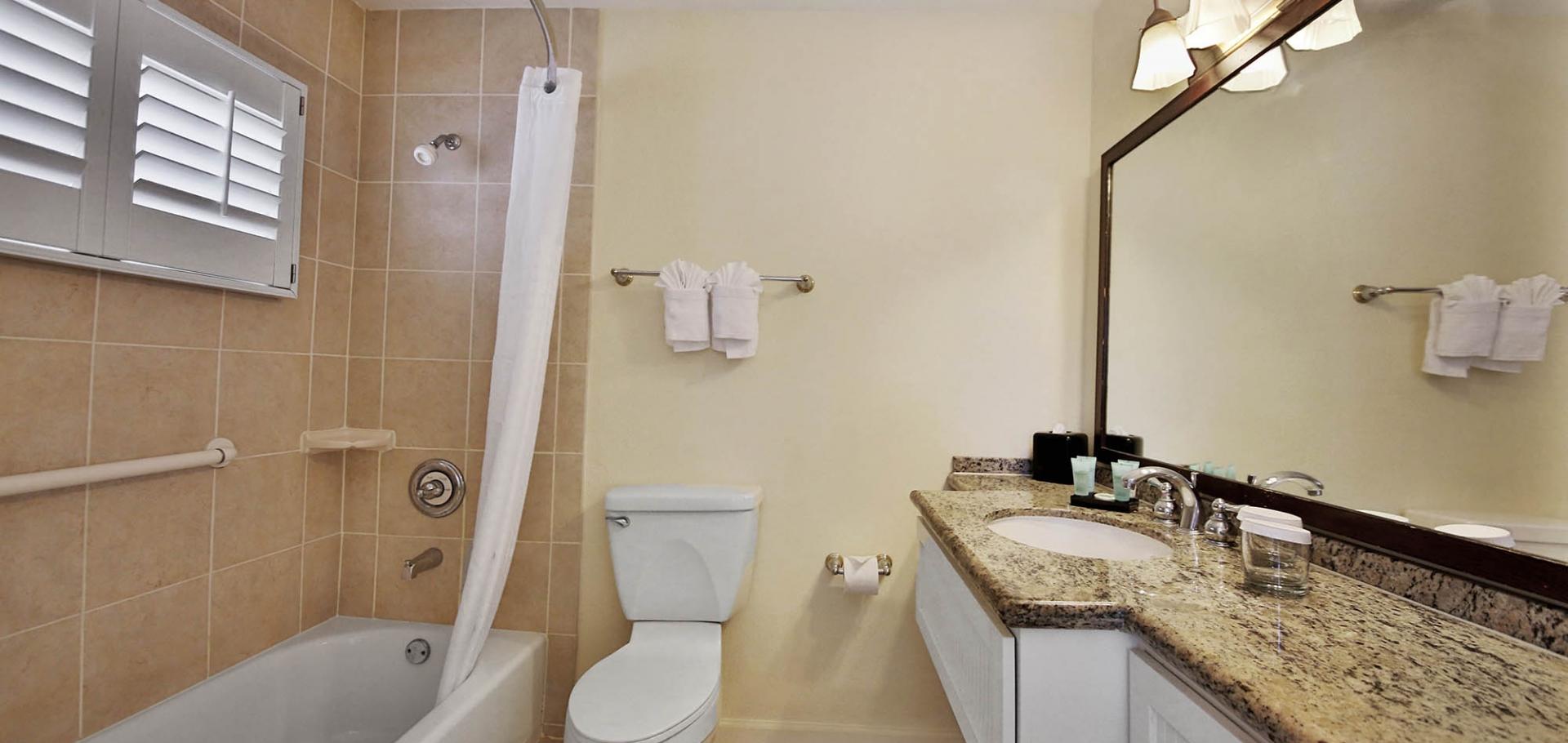 Sanibel Seaside Inn bathroom, bath, shower, and amenities