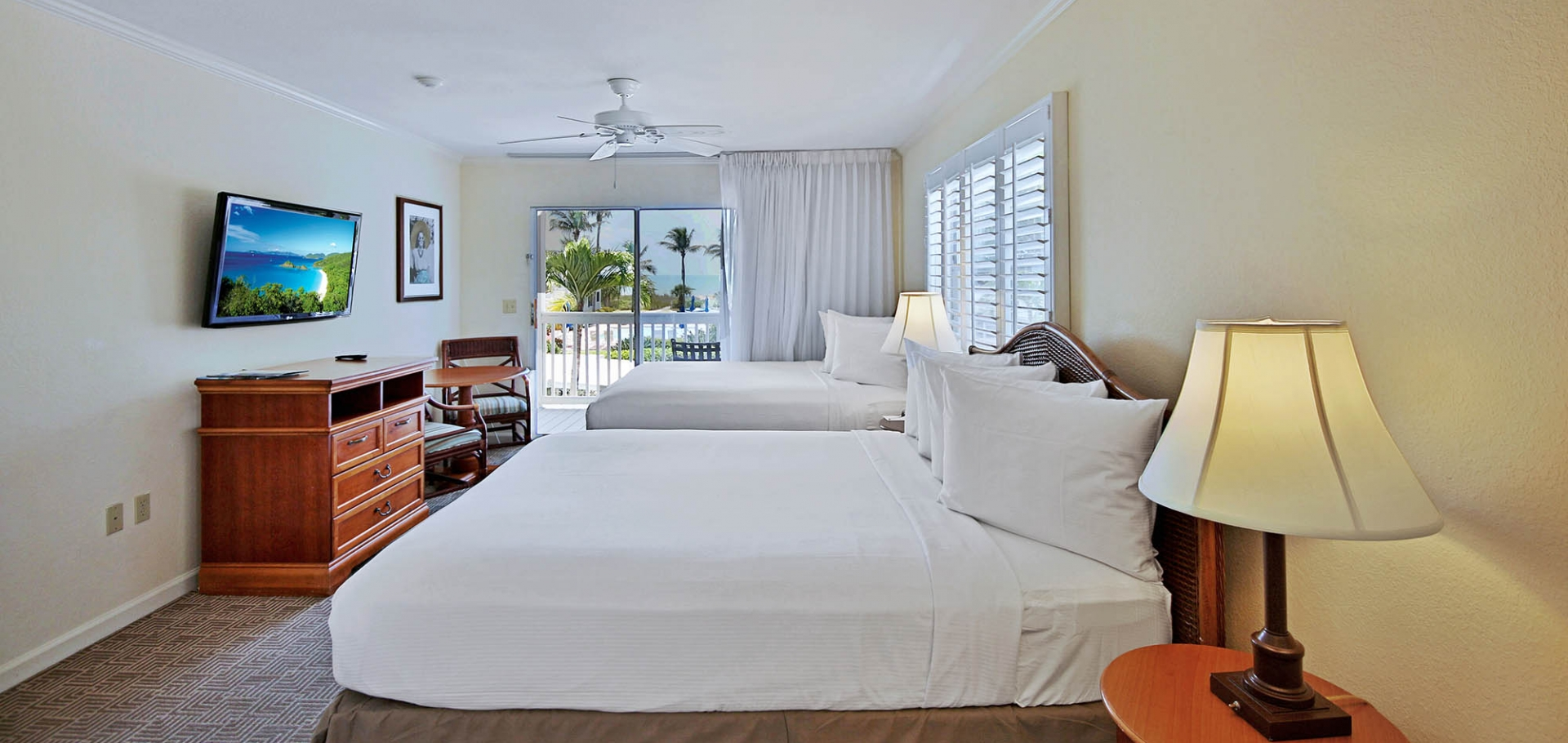 Sanibel's Seaside Inn guest room with two beds and balcony view