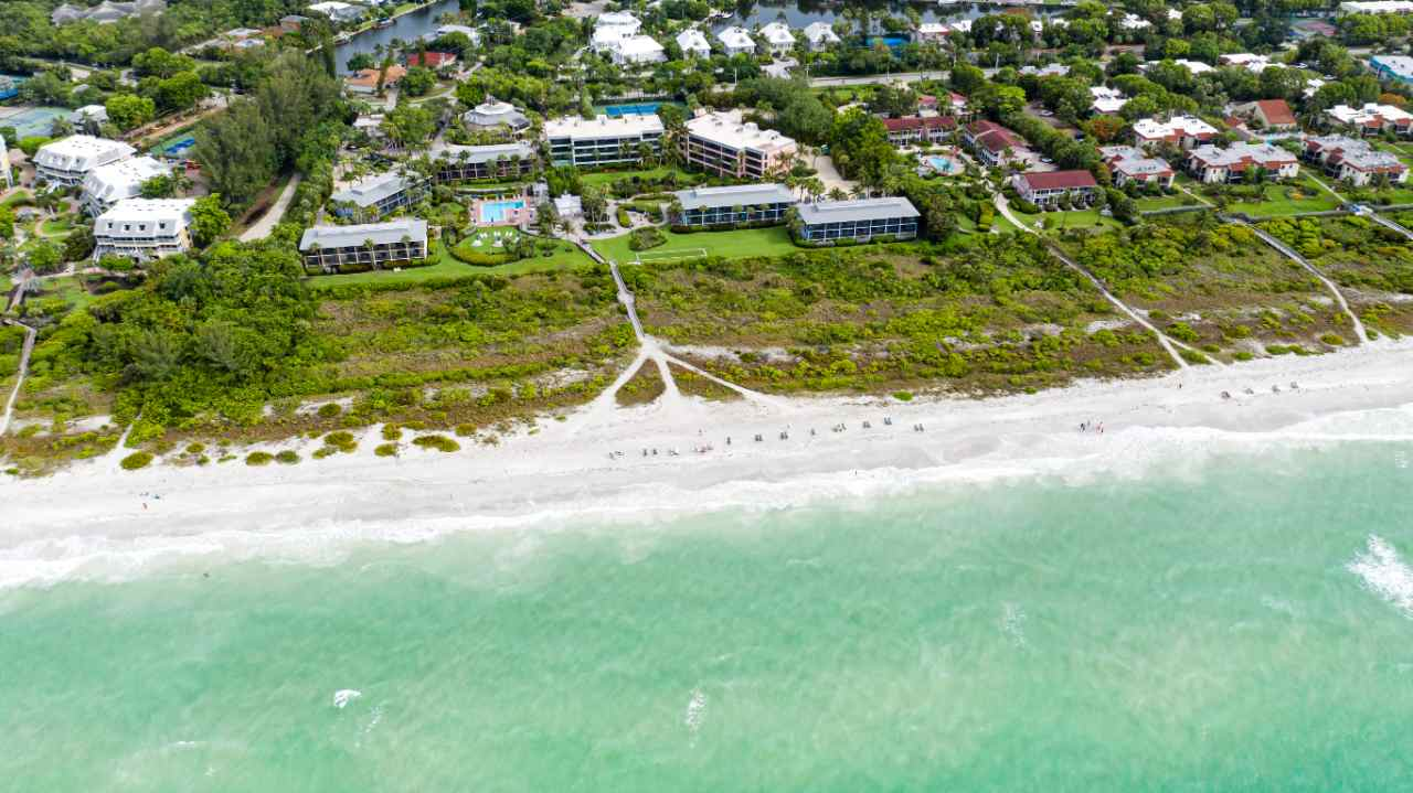 Aerial view of the beach with emerald green waters